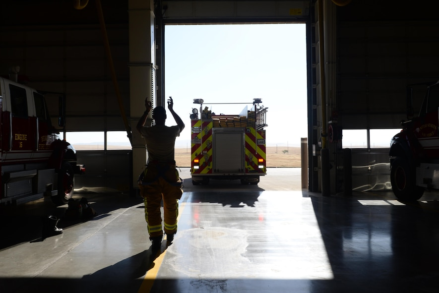 Senior Airman Silviu Feceu, 940th Civil Engineer Squadron (CES) firefighter, guides an engine operator into a parking bay June 30, 2016, at Beale Air Force Base, California. The Beale Fire Department's responsibility is to protect base personnel, property and the environment from fire and disaster on the installations approximately 23,000 acres. (U.S. Air Force photo by Senior Airman Ramon A. Adelan)
