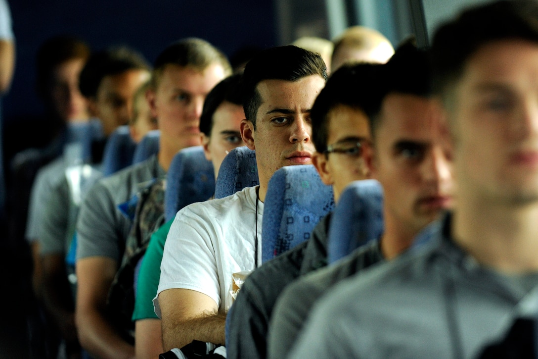 Cadet trainees share a pensive moment June 30, 2016,while traveling to the cadet area via bus to begin Basic Cadet Training. In all, 1,157 young adults were scheduled to report to the Academy for BCT, a six-week mental and physical training program. (U.S. Air Force photo/Jason Gutierrez)