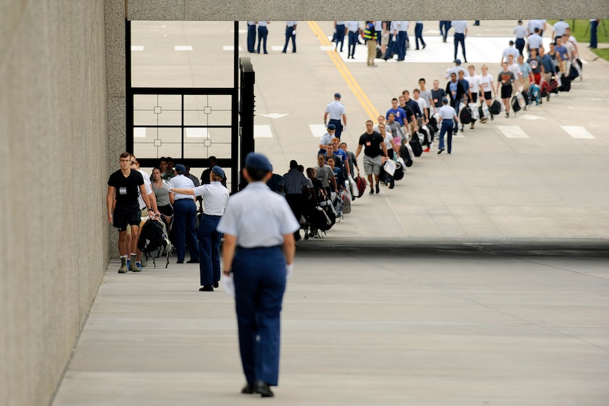 Scores of young adults with appointments to the U.S. Air Force Academy arrive at the cadet area June 30, 2016, to begin Basic Cadet Training. Basic Cadet Training is a six-week mental and physical training program designed to introduce cadet-trainees to military life. (U.S. Air Force photo/Jason Gutierrez)