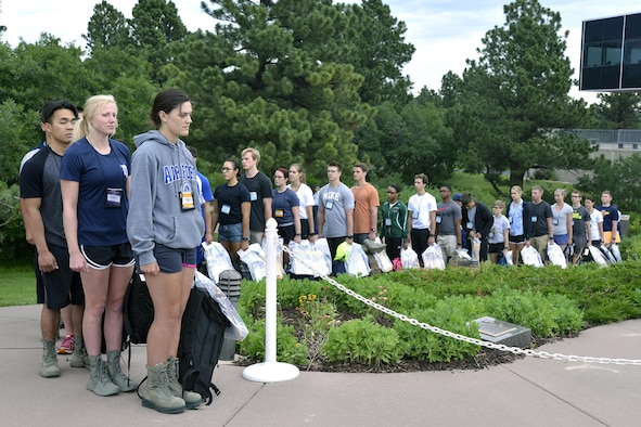 More than 1,000 young adults with appointments to the U.S. Air Force Academy lined up near Doolittle Hall June 30, 2016, at the Academy to report for Basic Cadet Training. Basic Cadet Training is a six-week mental and physical training program designed to introduce cadet trainees to military life. (U.S. Air Force photo/Jason Gutierrez) )