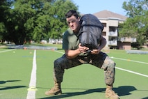 Sgt. Nick Perrorazio, a machine gunner with 2nd Battalion, 8th Marine Regiment demonstrates a sandbag squat during the 2016 Tactical Athlete of the Year competition at the High Intensity Tactical Training center on Marine Corps Base Camp Lejeune, June 13. The competition is being held yearly to find the fittest tactical athletes in the Marine Corps. Winners from Marine Corps Installations – East will go on to compete at Marine Corps Air Station Miramar to earn the title of Tactical Athlete of the Year.