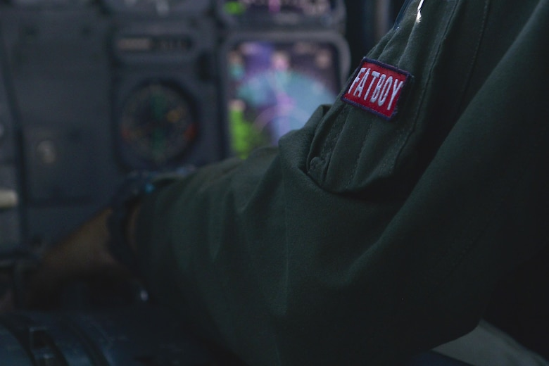 "A U.S. Air Force KC-10 Extender pilot dons the ""Fat Boy"" patch as he supports the F-35A Lightning II's first transatlantic aerial refueling over the Atlantic Ocean June 30, 2016. ""Fat Boy"" refers to pilots' whose first operational aircraft assignment is to fly the KC-10 Extender, which is considered a heavy aircraft due to its size and capabilities. (U.S. Air Force photo by Staff Sgt. Natasha Stannard)"