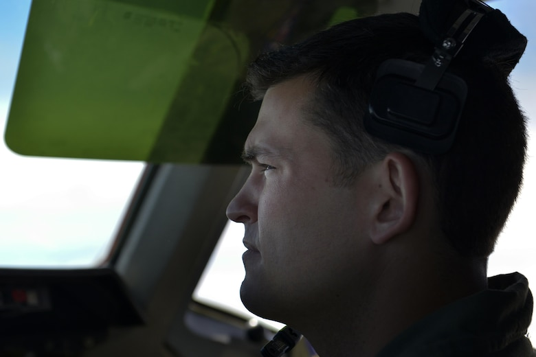 U.S. Air Force Capt. Brad Mcelvain, 9th Air Refueling Squadron KC-10 Extender pilot, looks to the horizon while flying a refueling mission in support of F-35A Lightning IIs over the Atlantic Ocean June 30, 2016. The F-35A is the Air Force's newest fifth generation fighter aircraft and is capable of multiple roles for air superiority. (U.S. Air Force photo by Staff Sgt. Natasha Stannard)