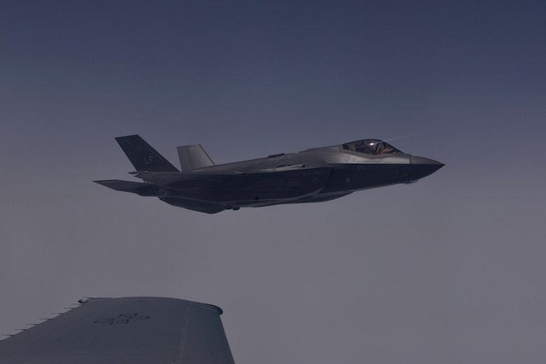 A U.S. Air Force F-35A Lightning II flies alongside a K-10 Extender over the Atlantic Ocean for the F-35A's first transatlantic flight June 30, 2016.The Extender, which is based out of Travis Air Force Base, Calif., refueled the Lightning on its way to England for the Royal International Air Tattoo. (U.S. Air Force photo by Staff Sgt. Natasha Stannard)