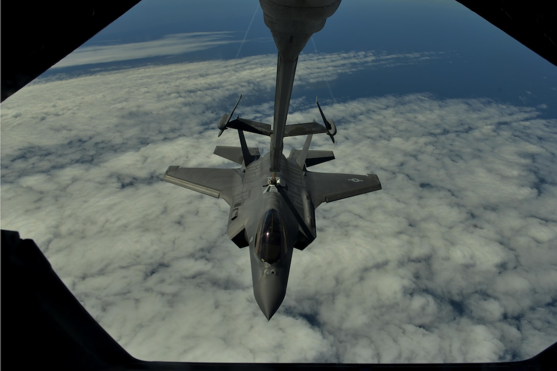 A U.S. Air Force F-35A Lightning II is refueled by a KC-10 Extender over the Atlantic Ocean on the way to Fairford, England, June 30, 2016. This flight marked the first U.S. transatlantic flight of the F-35A. (U.S. Air Force photo by Staff Sgt. Natasha Stannard)