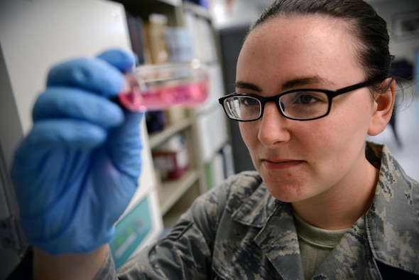 Senior Airman Samantha Parkhurst, 47th Medical Operations Squadron bioenvironmental engineering technician, looks at a water sample at the medical clinic on Laughlin Air Force Base, Texas, June 28, 2016. The bioenvironmental team tests Laughlin's base and marina water monthly to ensure safety. (U.S. Air Force photo/Senior Airman Ariel D. Partlow)