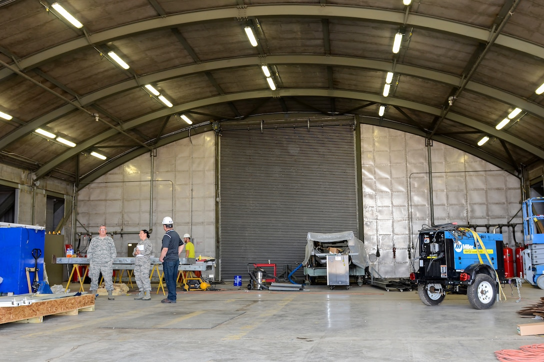 """The South Carolina Air National Guard's Enclosed Noise Suppression System Structure, or """"hush house,"""" undergoes renovations at McEntire Joint National Guard Base, S.C., March 10, 2016.  The renovations occur approximately once every 10 years to keep the structure free of rust and other environmental elements that naturally occur over time. (U.S. Air National Guard photo byAirman 1st Class Megan Floyd)"""