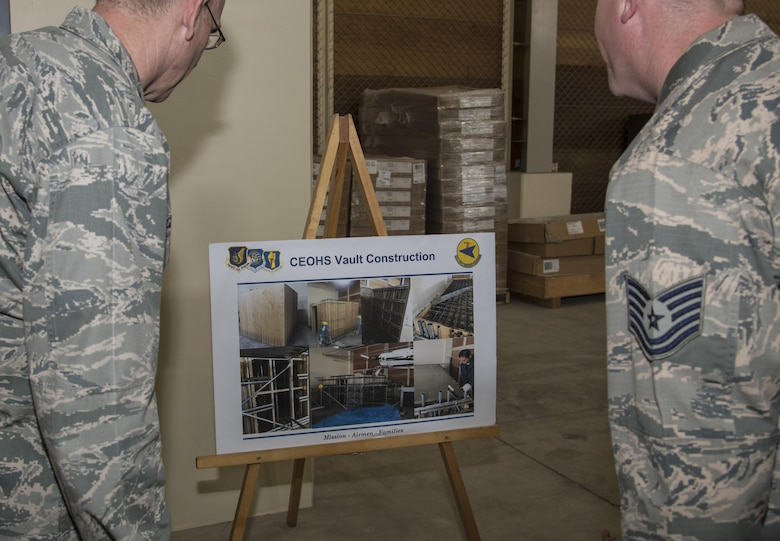 U.S. Air Force Maj. Gen. Timothy S. Green, the Air Force Director of Civil Engineers and Deputy Chief of Staff for logistics, engineering and force protection with Headquarters U.S. Air Force, left, and Tech. Sgt. Glenn Traylor, carpentry shop NCO in charge with the 35th Civil Engineer Squadron, right, view vault construction photos at Misawa Air Base, Japan, July 1, 2016. The vault was built in conjunction with a new explosive ordnance disposal compound. In addition to building the vault, updates were made to the breakrooms, bathrooms and storage units. The improvements ensured a smooth transition for EOD Airmen from their old to new compound. (U.S. Air Force photo by Senior Airman Jordyn Fetter)