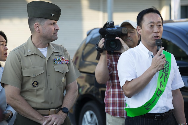 The Honorable Yoshihiko Fukuda, mayor of Iwakuni, Japan, right, and U.S. Marine Corps Col. Robert V. Boucher, commanding officer of Marine Corps Air Station Iwakuni, address a crowd and local Japanese media before participating in the seventh Joint Leadership Walk down the streets of Iwakuni on July 6, 2016. The last walk took place in December 2015 and continues to be a firm demonstration of the bond and unity between both communities. (U.S. Marine Corps photo by Lance Cpl. Donato Maffin/Released)