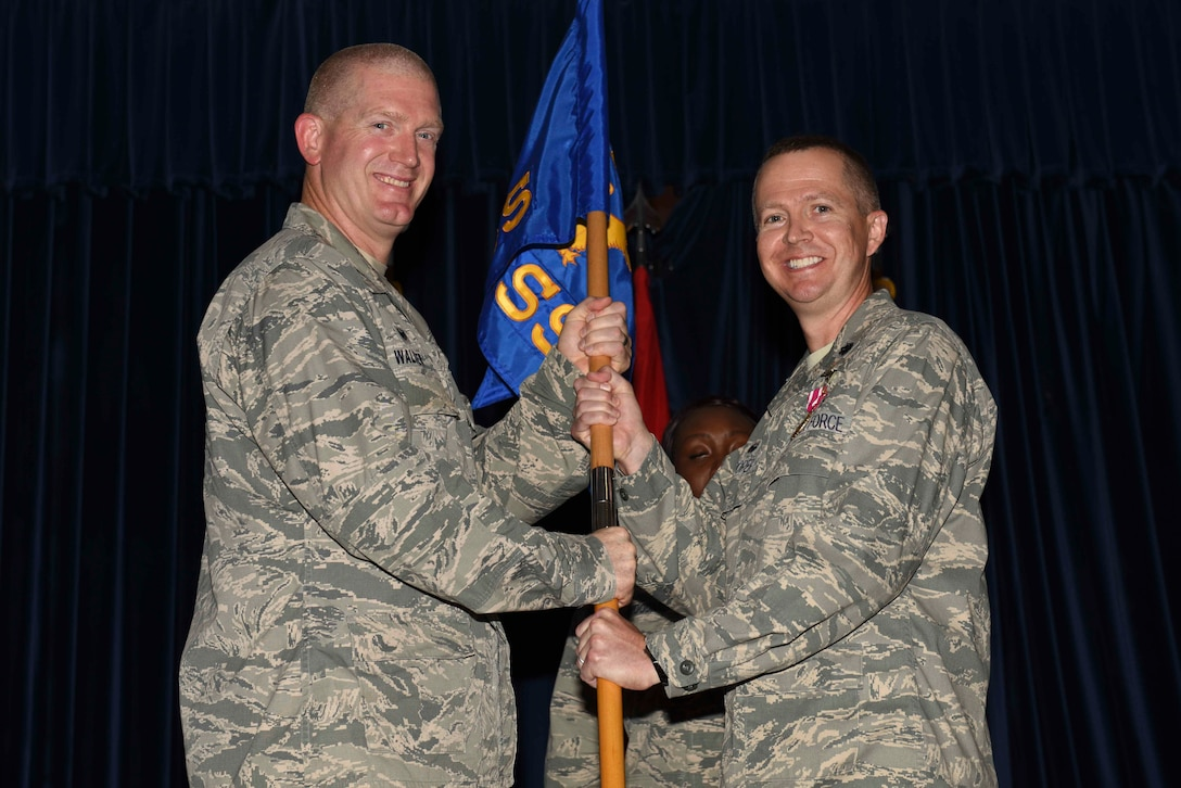 U.S. Air Force Lt. Col Jeremy Hooper, 39th Medical Support Squadron outgoing commander, relinquishes command to U.S. Air Force Col. John Walker, 39th Air Base Wing commander, July 7, 2016, at Incirlik Air Base, Turkey. While the 39th MDSS commander, Hooper was responsible for and directed the budget to sustain group personnel and providing healthcare to personnel across Turkey. (U.S. Air Force photo by Airman 1st Class Devin M. Rumbaugh/Released)