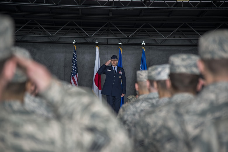 Airmen from the 35th Fighter Wing render their first salute to U.S. Air Force Col. R. Scott Jobe, 35th FW commander, during a change of command ceremony at Misawa Air Base, Japan, July 7, 2016. Prior to arriving at Misawa AB, Jobe was the J53 contingency planning division chief with U.S. Southern Command. (U.S. Air Force photo by Senior Airman Brittany A. Chase)