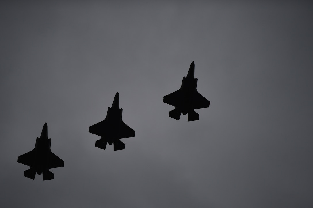 Three F-35A Lightning II's fly over RAF Fairford, United Kingdom, June 30, 2016. The 5th generation fighters made the transatlanic flight with help from the mid-air refueling of a KC-10 tanker. (U.S. Air Force photo by Tech. Sgt. Jarad A. Denton/Released)