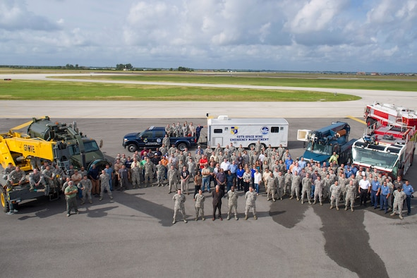 Members of the 45th Civil Engineer Squadron pose for a group photo in November 2015 at Patrick Air Force Base, Fla. The group won Air Force Space Command's Outstanding Large Civil Engineer Unit Award for 2015 plus four other unit awards and ten individual awards. Three members were recognized at the Air Force level. (U.S. Air Force photo by Matthew Jurgens/Released)