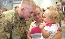 "After staring at her father from her mother's arms for a while, 16-month-old Shaelynn finally decided to go to Sgt. Colton Hoefling of the 1st Battalion, 18th Infantry Regiment, 2nd Armored Brigade Combat Team, 1st Infantry Division. Hoefling returned to Fort Riley on June 21 with about 250 Soldiers from the ""Dagger"" brigade following a nine-month deployment to Southwest Asia."