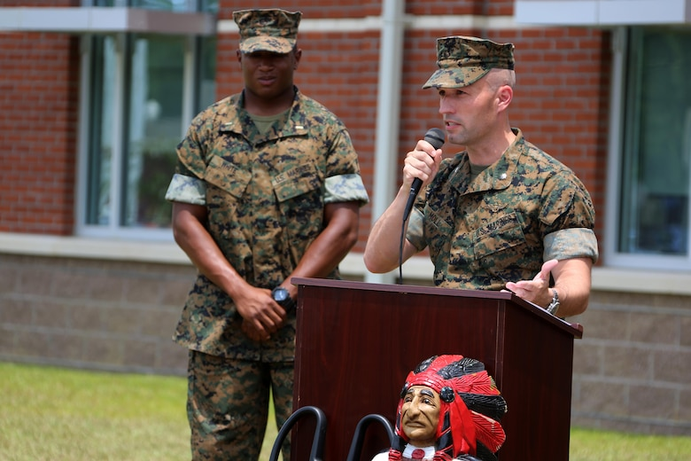 Lt. Col. Brian Moll addresses a crowd during a ribbon cutting ceremony at Marine Corps Air Station Cherry Point, N.C., June 24, 2016. Marine  Air Support Squadron 1 received a new, state-of-the-art facility to support several of its units, including the communications, electronics, headquarters and service, and air support company, as well as the unit's supply section. The complex, which represents a new era of technology for the squadron and the Marine Corps, supports better quality training operations using a new battle lab capable of recreating realistic training missions with outside entities or other communications assets. MASS-1 is an aviation command and control unit responsible for the planning, receiving, coordination, processing of requests for direct or close air support. Moll is the MCAS Cherry Point executive officer. (U.S. Marine Corps photo by Cpl. N.W. Huertas/Released)