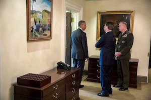 President Barack Obama talks with Defense Secretary Ash Carter and Marine Corps Gen. Joe Dunford Jr., chairman of the Joint Chiefs of Staff, outside the outer Oval Office at the White House, July 6, 2016, following a statement to the press on Afghanistan. White House photo by Pete Souza