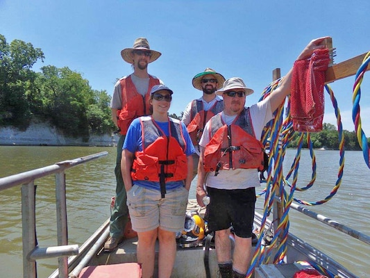 Memphis District Dive Team members on a survey trip to U.S. Coast Guard Foscue Creek Station to ensure federally threatened mussels are not endangered by a proposed dredging operation. (Rear, left to right) Josh Koontz, Mike Thron. (Front, left to right) Andrea Carpenter, Mark Smith.