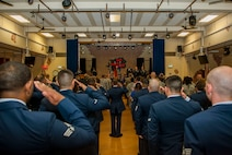 Members of the 52nd Medical Support Squadron salute in formation during the 52nd MDSS change of command ceremony in the Brickhouse on Spangdahlem Air Base, Germany, June 30, 2016. Family and friends of both the outgoing and incoming 52nd MDSS commanders of the attended the ceremony. (U.S. Air Force photo by Airman 1st Class Timothy Kim/Released)