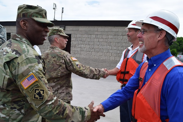 Command Sgt. Maj. Antonio Jones, U.S. Army Corps of Engineers and Lt. Gen. Todd Semonite, USACE commanding general, greets Donald Fogel, Pittsburgh District Maintenance Branch chief, and Dane Summerville, district dive coordinator, at Montgomery Locks and Dam on the Ohio River, June 22.