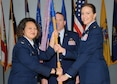 Col. Imelda Reedy, 14th Medical Group Commander, passes the 14th Medical Support Squadron guidon to Lt. Col. Jennifer Baggott, the new 14th MDSS Commander, during a change of command ceremony July 1 at Columbus Air Force Base, Mississippi. (U.S. Air Force photo/Melissa Doublin)