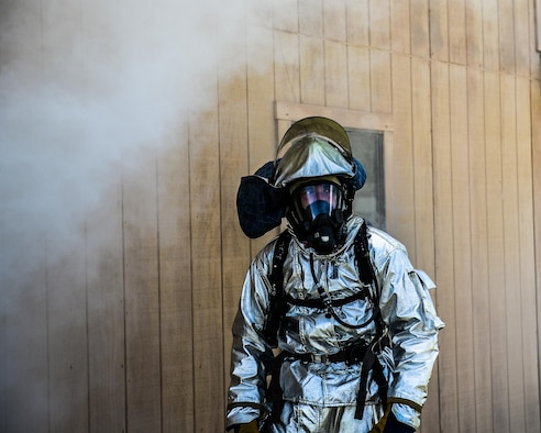 A U.S. Air Force firefighter waits to begin a burning building rescue exercise at Tyndall Air Force Base's Silver Flag exercise site, June 24, 2016. Firefighters receive special hands-on training at the Silver Flag site. The 823rd RED HORSE's primary wartime responsibility is to provide a highly rapid-deployable, self-sufficient civil engineer response force to support contingency and special operations worldwide. (U.S. Air Force photo by Airman 1st Class Cody R. Miller/Released)