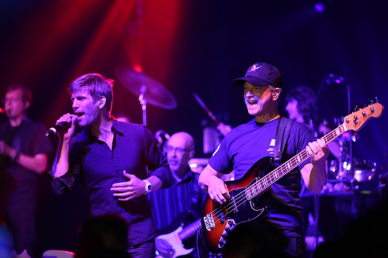 Jeff Vezain (left) and Gary Sinise perform on the Two Rivers Theater stage at Marine Corps Air Station Cherry Point, N.C., July 5, 2016. Gary Sinise and the Lt. Dan Band have participated in 70 United Service Organization tours since they came together. In total, they have entertained more than 363,000 service members and military families in 13 countries. The band puts on shows to raise spirits, funds and awareness for severely wounded warriors in need. Vezain is a vocalist and acoustic guiter player, while Sinise is the electric bass player with the Lt. Dan Band. (U.S. Marine Corps photo by Lance Cpl. Mackenzie Gibson/Released)