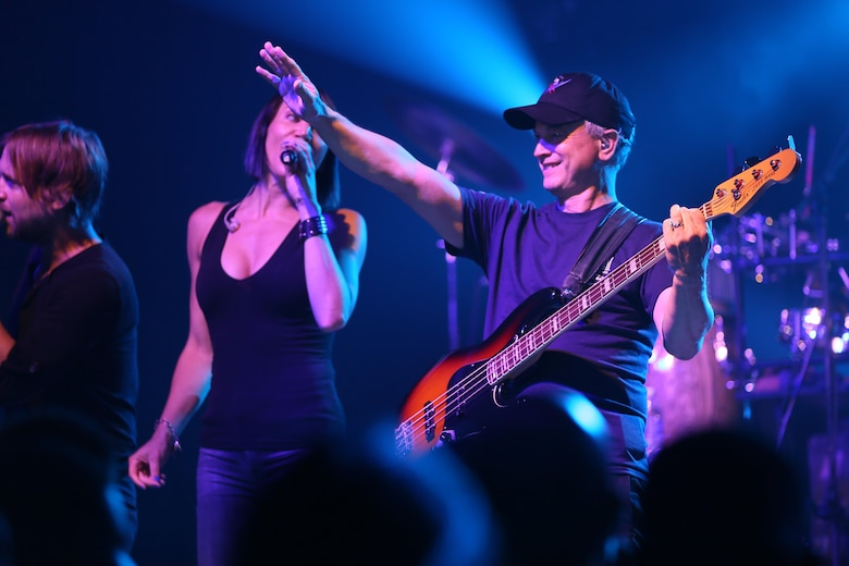 Gary Sinise waves to the crowd during a performance on the Two Rivers Theater stage at Marine Corps Air Station Cherry Point, N.C., July 5, 2016. Gary Sinise and the Lt. Dan Band have participated in 70 United Service Organization tours since they came together. In total, they have entertained more than 363,000 service members and military families in 13 countries. The band puts on shows to raise spirits, funds and awareness for severely wounded warriors in need. (U.S. Marine Corps photo by Lance Cpl. Mackenzie Gibson/Released)