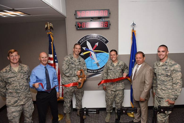 1st Lt. Timothy Urista, Space and Missile Systems Center Engineering Launch Support System program manager, Victor Folk, ManTech program manager, Lt. Col. Kris Barcomb, 1st Air and Space Test Squadron commander, Capt. Megan Harkins, SpaceX mission integrator and FLSC project lead, Craig Cumberland, ManTech Systems Engineering and Integration contractor and lead project engineer, and Capt. Nathan Fisher, 1st ASTS mission support flight deputy commander, complete a ribbon-cutting ceremony at the finalized Falcon Launch Support Center, June 24, 2016, Vandenberg Air Force Base, Calif. The 1st ASTS recently completed a project on two launch support centers – the Falcon Launch Support Center and the Mission Assurance Readiness Site -- that will be key to posturing the 30th Launch Group to support future government missions launching on SpaceX rockets. (U.S. Air Force photo by Airman 1st Class Robert J. Volio/Released)