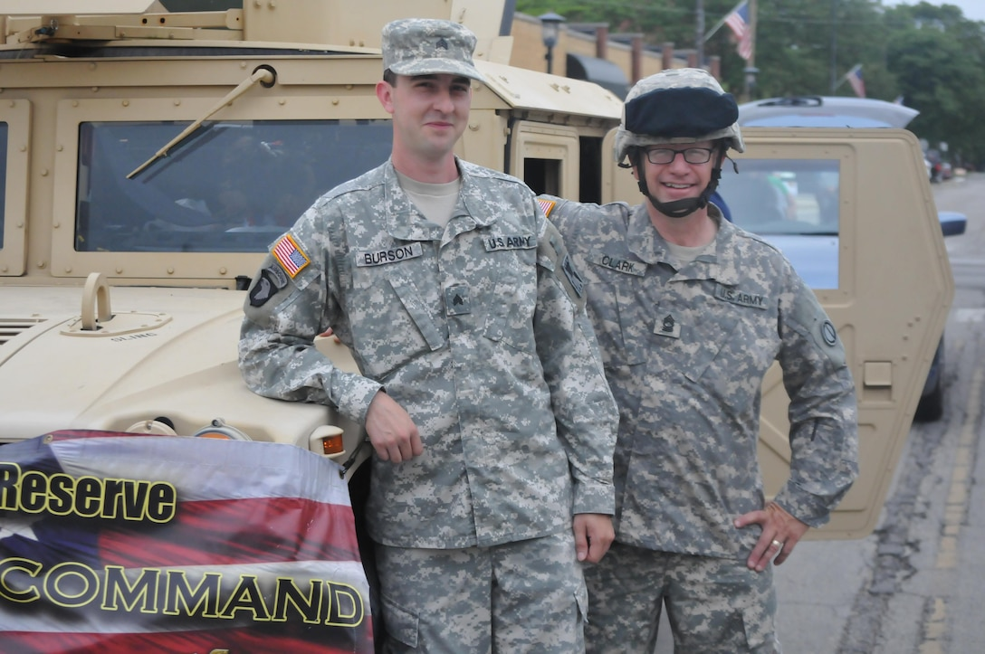Sgt. Adam Burson, left, and Master Sgt. Keith Clark pose in front of a Humvee before the Independence Day parade gets underway in Villa Park, Illinois, Jul. 4, 2016. The 416th Theater Engineer Command of Darien, Illinois provided the Humvee as a static display to the community and as a participant in the parade that followed. (U.S. Army photo by Spc. Brianna Saville/Released)