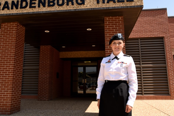 U.S. Army Sgt. Alicia Seeley, 316th Training Squadron student, stands in front of Brandenburg Hall on Goodfellow Air Force Base, Texas, July 1, 2016. Seeley is the Goodfellow Student of the Month Spotlight for June, 2016, a series highlighting Team Goodfellow students. (U.S. Air Force photo by Senior Airman Joshua Edwards/Released)