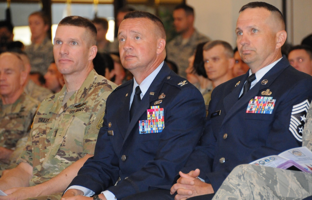 Sgt. Maj. of the Army Daniel A. Dailey (left) joins Col. Frederick D. Thaden, commander of Joint Base McGuire-Dix-Lakehurst (center) and Chief Master Sgt. Craig Poling, command chief master sergeant, JBMDL, during the 2016 Joint Base Service member of the Year ceremony July 7. This event was part of a two-day visit to New Jersey's joint base that included a tour of the base's key mission and training assets as well as a town hall meeting with Soldiers and Army civilians. A driving force behind Dailey's visit to the base is the Army's number-one priority of readiness, which allows the Total Army to continue to answer our nation's calls, in an increasingly volatile and uncertain world.