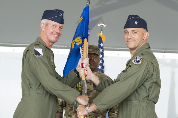 U.S. Air Force Col. James Boster, 14th Operations Group commander, and Lt. Col. Ryan Hill, 81st Fighter Squadron incoming commander, pose for a photo, during a change of command ceremony, July 7, 2016, at Moody Air Force Base, Ga. The 81st FS reactivated in January 2015 as a part of the 14th Flying Training Wing and currently conducts training operations as a tenant unit at Moody. (U.S. Air Force photo by Senior Airman Ceaira Tinsley/ Released)