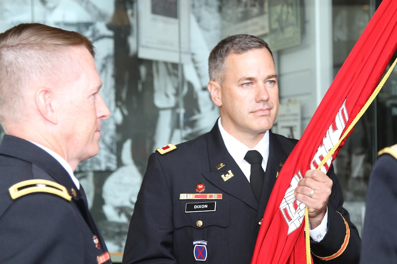 Col. Robert Dixon (right) holds the Army Corps of Engineers flag, and with it command of the Corps' Little Rock District, as Brig. Gen. David C. Hill, the Corps' Southwestern Division Commander looks on during the district change of command ceremony.  The event was held July 7 at the Witt Stephens Jr. Central Arkansas Nature Center in downtown Little Rock.  (Photo courtesy of the Army Corps of Engineers)