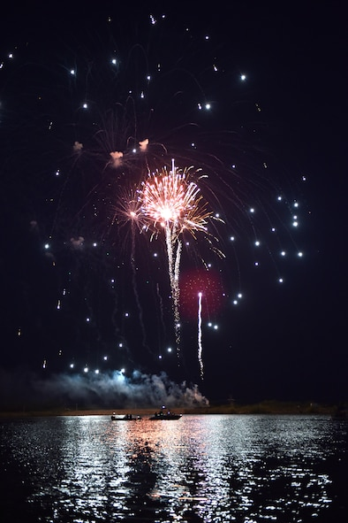 Fireworks explode over boats on Lake Nasworthy during the 4th of July Celebration in San Angelo, Texas, July 4, 2016. Participants could rent boats or sit alongside the bank of Lake Nasworthy to view the fireworks display. (U.S. Air Force photo by Airman 1st Class Caelynn Ferguson/Released)