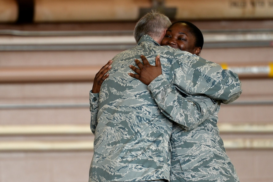 Lt. Gen. Darryl Roberson, Air Education and Training Command commander, hugs Master Sgt. Raneisha Russum, 82nd Force Support Squadron, manpower superintendent, after sharing her story of resiliency at Sheppard Air Force Base, Texas, June 29, 2016. The general was personally inspired by her story and recognized her during an all call with more than 3,000 Airmen. (U.S. Air Force photo by Senior Airman Kyle E. Gese)