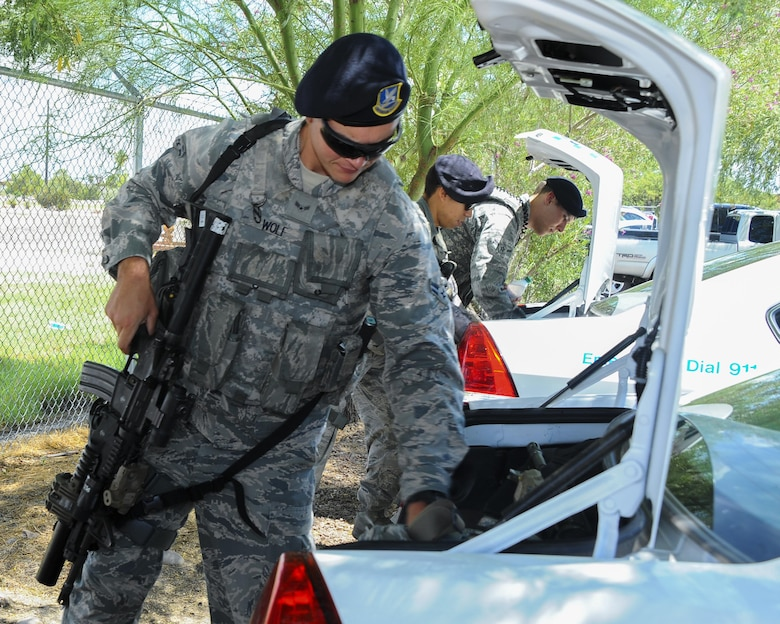 U.S. Air Force Airman 1st Class Matthew Wolf, 355th Security Forces Squadron member, loads his equipment into a vehicle at Davis-Monthan Air Force Base, Ariz., July 7, 2016. The 355th SFS mission is to protect, defend and fight to enable Air Force, joint and coalition mission success. (U.S. Air Force photo by Airman 1st Class Mya M. Crosby/Released)