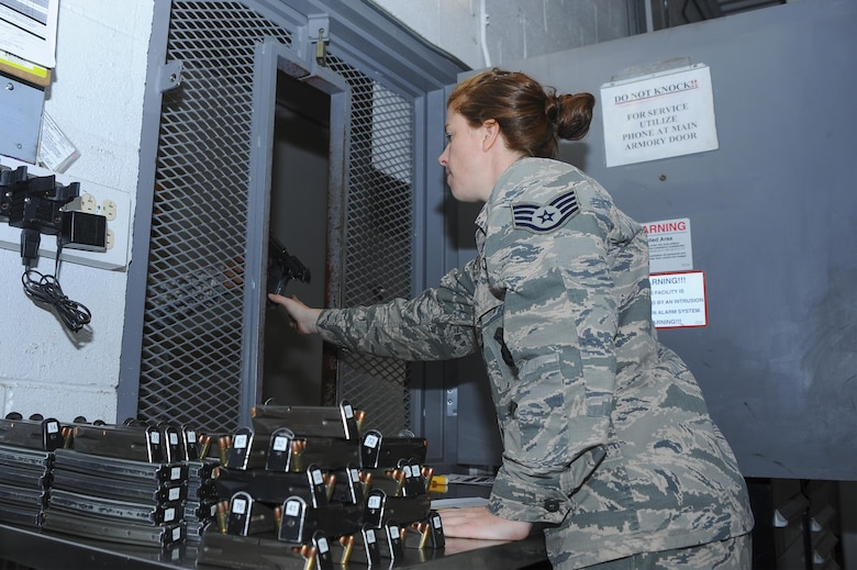 U.S. Air Force Staff Sgt. Alexandra Sullivan, 355th Security Forces Squadron member, collects equipment from SFS personnel at Davis-Monthan Air Force Base, Ariz., July 1, 2016. Security Forces members are responsible for ensuring the safety of base weapons, property and personnel from hostile forces. (U.S. Air Force photo by Airman 1st Class Mya M. Crosby/Released)