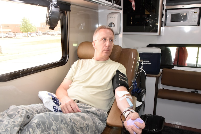 SIOUX FALLS, S.D.-Master Sgt. Jon Graff, 114th Logistics Readiness Squadron supply technician, is the 7,000 donation for the South Dakota Air National Guard during the blood drive July 7.  Base staff has helped over 21,000 patients by donating 875 gallons since 1991.  The July blood drive marks the 144th blood drive held at Joe Foss Field. (U.S. Air National Guard photo by Tech. Sgt. Abbey Rotter/Released).