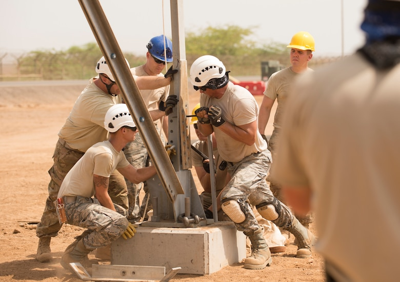 U.S. Air Force Airmen of the 205th Engineering Installation Squadron, Oklahoma City, line up pieces of the metal frame during construction of an AN/GPN-27 Airport Surveillance Radar System tower, May 26, 2016, at Camp Lemonnier, Djibouti. The new radar is a more permanent replacement for the short-term radar currently in operation. (U.S. Air Force photo by Staff Sgt. Tiffany DeNault)
