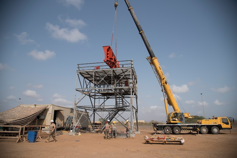 U.S. Air Force Airmen of the 205th Engineering Installation Squadron, Oklahoma City install a new AN/GPN-27 Airport Surveillance Radar System tower, June 4, 2016, at Camp Lemonnier, Djibouti. With coordination between the 205 EIS, U.S. Air Forces in Europe, U.S. Air Force Flight Standards Agency, U.S. Air Force Central Command and the U.S. Navy, the new radar will increase air traffic control capabilities and safety. (U.S. Air Force photo by Staff Sgt. Tiffany DeNault)