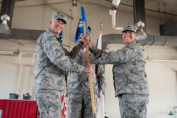 Col. Kerry Proulx, 51st Mission Support Group commander, accepts the unit guidon from Col. Andrew Hansen, 51st Fighter Wing commander, during a change-of-command ceremony at Osan Air Base, Republic of Korea, July 6, 2016. The group, made up of five diverse squadrons totaling more than 2,600 personnel, supports the Air Force's most permanently forward-deployed wing, a numbered Air Force and 20 tenant units. (U.S. Air Force photo by Staff Sgt. Jonathan Steffen/Released)