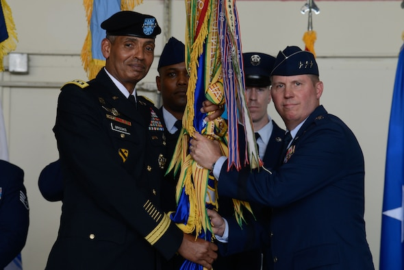 Lt. Gen. Thomas W. Bergeson accepts the Seventh Air Force guidon from Gen. Vincent K. Brooks, U.S. Forces Korea commander, during a change of command ceremony at Osan Air Base July 8, 2016. Bergeson became the 34th commander of Seventh Air Force, taking over for Lt. Gen. Terrence J. O'Shaughnessy who moves on to take over as Pacific Air Forces commander. (U.S. Air Force photo by Senior Airman Dillian Bamman/Released)