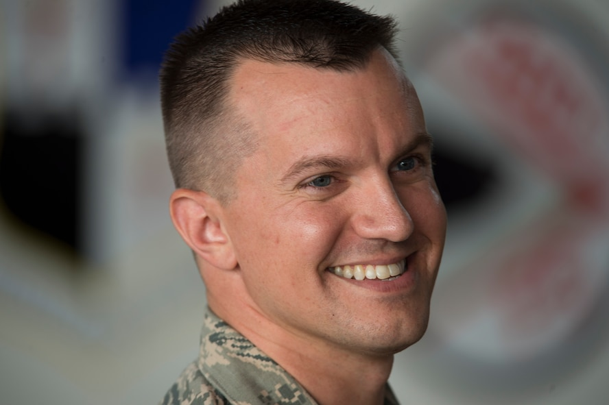 U.S. Air Force Maj. John Szcepanski, incoming 52nd Aircraft Maintenance Squadron commander, smiles as he shakes hands with fellow Airmen after an assumption of command ceremony at Hangar One on Spangdahlem Air Base, Germany, July 8, 2016. Szcepanski assumed command of the squadron and previously served as a maintenance operations officer for the 756th AMXS at Luke Air Force, Base, Ariz. (U.S. Air Force Photo by Staff Sgt. Joe W. McFadden/Released)