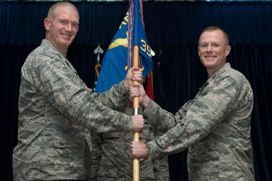 U.S. Air Force Col. Todd Stratton, 39th Mission Support Group incoming commander, receives command from U.S. Air Force Col. John Walker, 39th Air Base Wing commander, during a change of command ceremony July 8, 2016, at Incirlik Air Base, Turkey. Prior to taking command, Stratton was the chief of defensive cyberspace operations at Headquarters U.S. Special Operations Command, MacDill Air Force Base, Fla. (U.S. Air Force photo by Senior Airman John Nieves Camacho/Released)