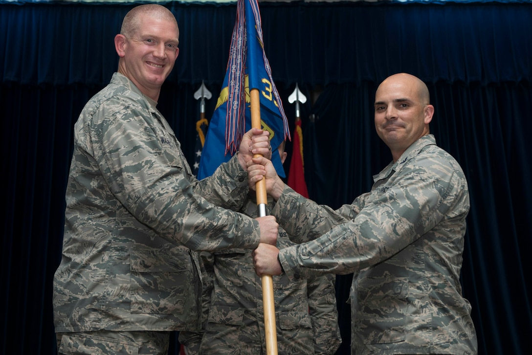 U.S. Air Force Col. Russell Voce, 39th Mission Support Group outgoing commander, relinquishes command to U.S. Air Force Col. John Walker, 39th Air Base Wing commander, during a change of command ceremony July 8, 2016, at Incirlik Air Base, Turkey. A change of command ceremony is a tradition that represents a formal transfer of authority and responsibility from the outgoing commander to the incoming commander. (U.S. Air Force photo by Senior Airman John Nieves Camacho/Released)