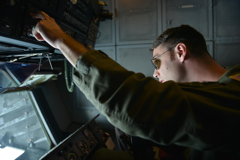 Senior Airman Erik Henry, a 9th Air Refueling Squadron boom operator, refuels an F-35A Lightning II from a KC-10 Extender over the Atlantic Ocean June 30, 2016. The F-35s traveled to Fairford, England, to support and perform in the Air Combat Command F-35A Heritage Flight for the Royal International Air Tattoo. (U.S. Air Force photo/Staff Sgt. Natasha Stannard)