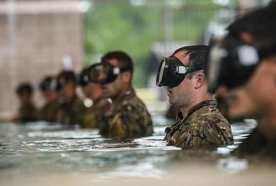 Special Tactics Training Squadron students line up during a pre-scuba class at Hurlburt Field, Fla., June 29, 2016. The training familiarizes trainees with the basics of water operations. The trainees perform tasks such as tying knots underwater, staying afloat without their arms and hands, and using snorkeling gear. (U.S. Air Force photo/Senior Airman Ryan Conroy)