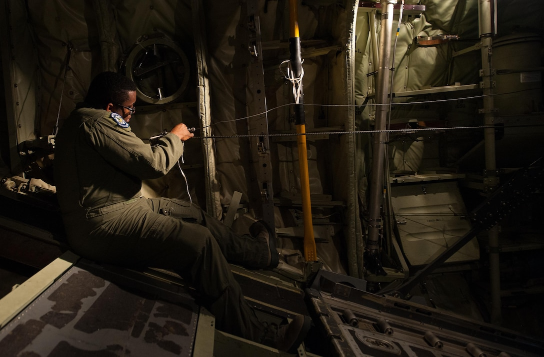 Senior Airman Warren Purnell, a 37th Airlift Squadron loadmaster, prepares a C-130J Super Hercules for takeoff during a joint airborne air transportability training exercise June 30, 2016, at Ramstein Air Base, Germany. Airmen maintain mission readiness by participating in exercises. (U.S. Air Force photo/Airman 1st Class Lane Plummer)