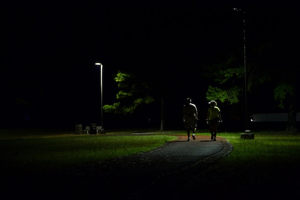 U.S. Air Force Master Sgt. Shawana Budde, 19th Force Support Squadron, right, walks with a volunteer from the 19th FSS throughout the night as she nears her goal of 24 hours straight 29 June, 2016, at Little Rock Air Force Base, Ark. Budde decided to walk for 24 hours straight when a member of her squadron was diagnosed with leukemia in an effort to raise more awareness to the disease as well as inspire all Airmen of Team Little Rock to take care of each other. (U.S. Air Force photo by Staff Sgt. Jeremy McGuffin)