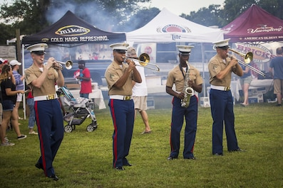The Parris Island Marine Band performs during an Independence Day celebration aboard Marine Corps Recruit Depot Parris Island July 4. Games and activities were set up for Marines and their families to participate before fireworks were set off.